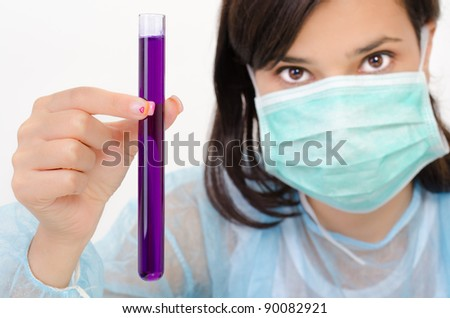 Close-up of glass tube with fluid in chemist hand - stock photo