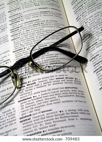 Close up of glasses on dictionary