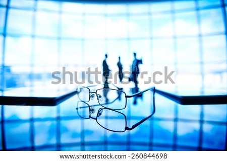Close-up of glasses on office table - stock photo