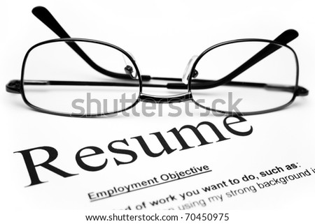 Close up of glasses on resume - stock photo