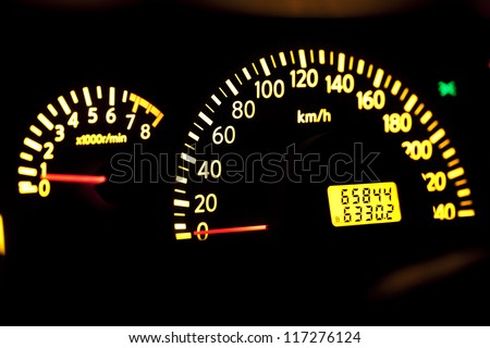 Close up of glow dashboard car speed meter
