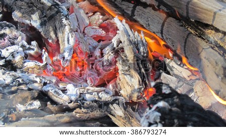 Close-up of glowing coals and fire. - stock photo