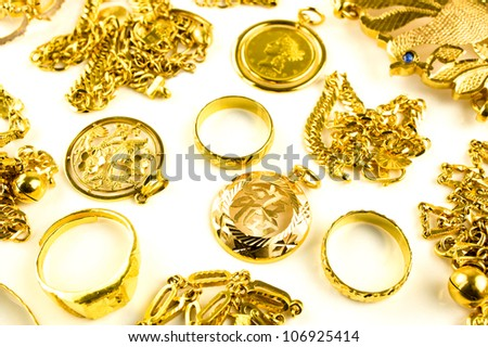Close up of Gold in varies jewelry form on white isolated background - stock photo