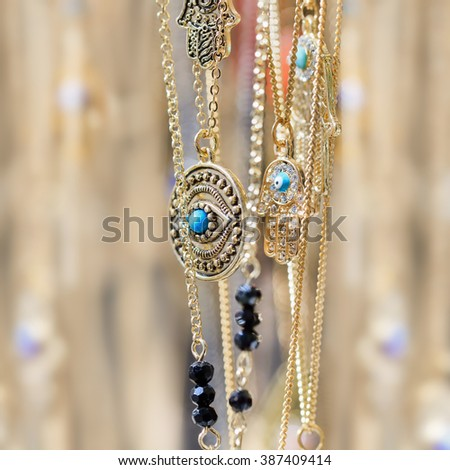 Close-up of gold necklaces with creamy background - stock photo