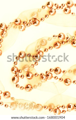 Close up of golden garland. Light background.