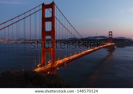 Close-up of Golden Gate Bridge at twilight viewed from cliffs on north side of bridge
