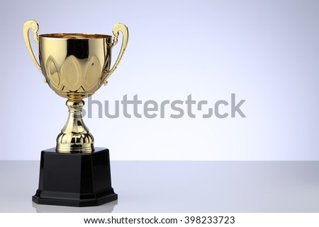 close up of golden trophy cup