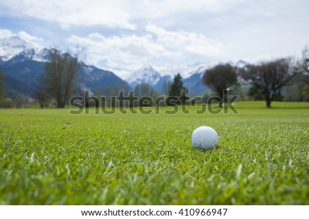Close up of golf ball in golf course in Alps