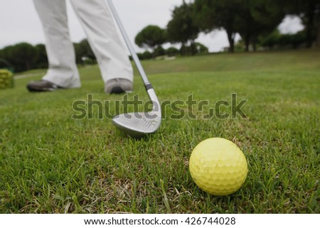 Close up of golf club making contact with golf ball