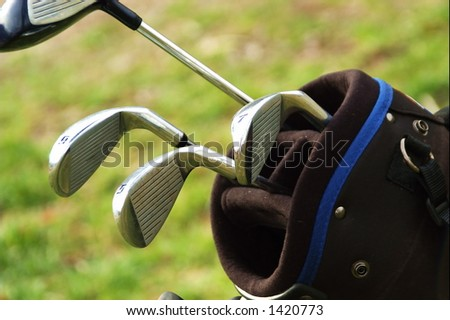 close up of golf clubs in golf bag - stock photo