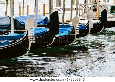 Close up of Gondolas moored at the pier near San Marco Square