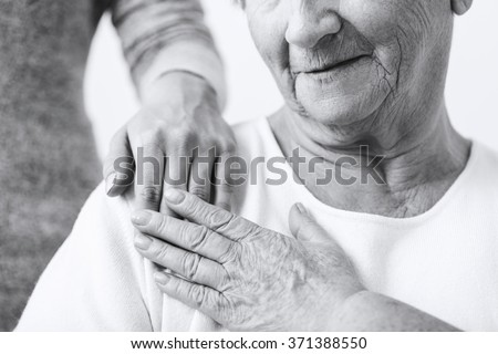 Close-up of granddaughter caring about grandma - stock photo