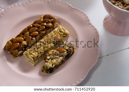 Close-up of granola bar in plate on white background