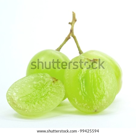 Close up of grapes in a basket on a white background - stock photo