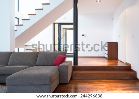 Close-up of gray sofa in beauty salon - stock photo