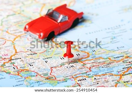 Close up of  Greece map  red pin and car toy - Travel concept  - stock photo