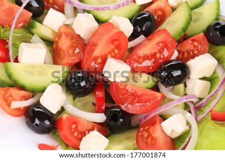 Close up of greek salad. Isolated on a white background.