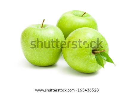 Close up of green apples, isolated on white. Concept of healthy eating and dieting lifestyle