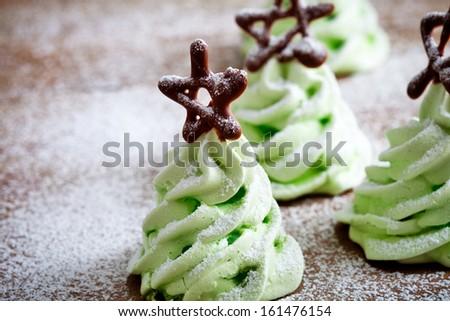 Close up of green christmas tree meringues - stock photo
