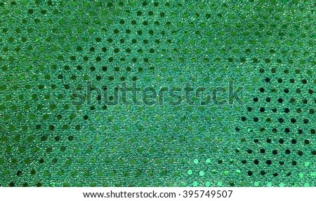 close up of green fabric with shiny sequins