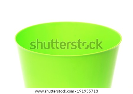 Close up of green flowerpot on a white background
