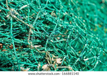 Close up of green industrial fishing net background - stock photo