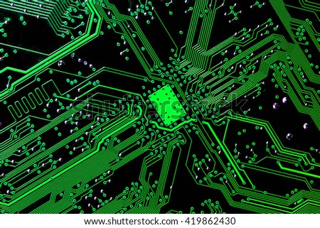 close-up of green motherboard with north bridge microchip pathways