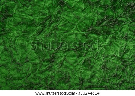 Close-up Of green Wrinkled texture background Paper Square Texture Vertical Background With Copy Space For Text Or Image