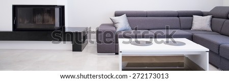 Close-up of grey comfortable sofa in new living room