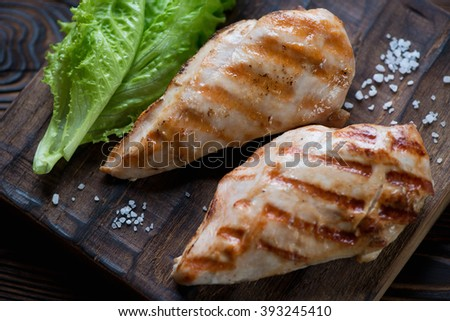 Close-up of grilled chicken breast filets, selective focus - stock photo