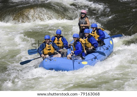 close-up of group of people riding the rapids in Colorado.