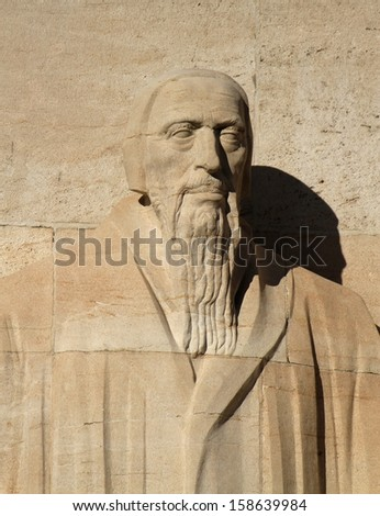 Close up of Guillaume Farel statue on reformation wall in Parc Des Bastions, Geneva, Switzerland.