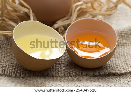 Close up of half egg over jute background.   - stock photo