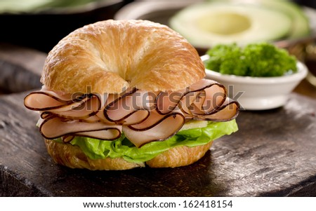 Close up of ham and cheese croissant sandwich. - stock photo