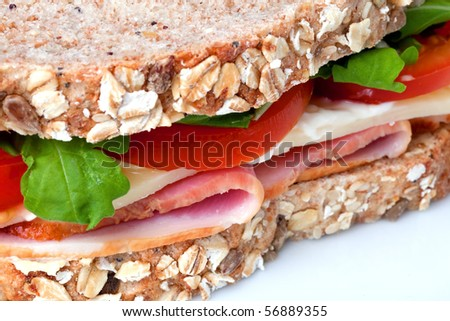 Close up of ham and cheese sandwich with lettuce and tomato - stock photo