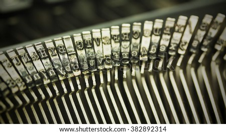 Close up of hammer keys on an old type writer. Shallow depth of field. Vintage style filter applied.
