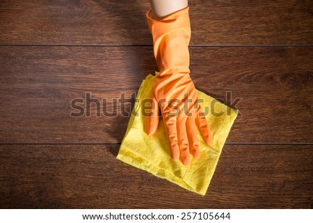 Close up of hand cleaning the wooden parquet - stock photo