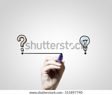 Close up of hand darwing line from question mark to idea - stock photo