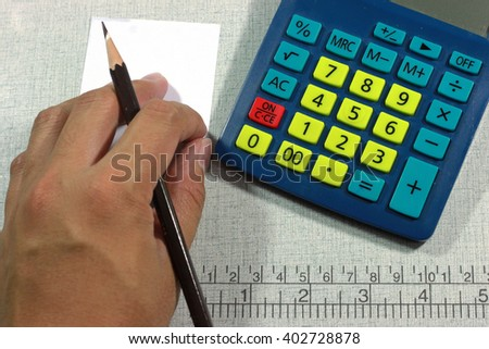 Close-up of hand doing calculations