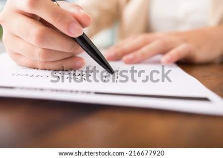 Close-up of hand feeling checklist - stock photo