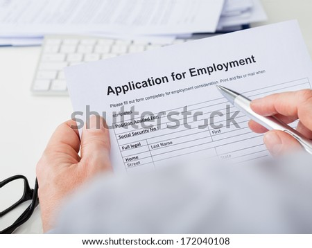 Close-up Of Hand Filling Application For Employment - stock photo