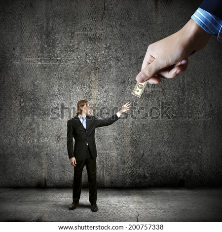 Close up of hand giving money to businessman - stock photo