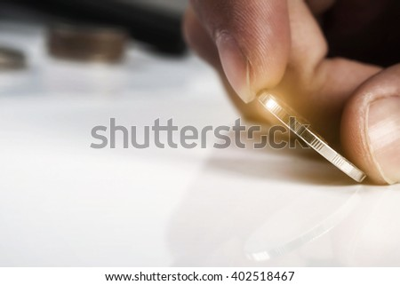 Close up of hand holding an coin with copy space, Business investment plan concept.