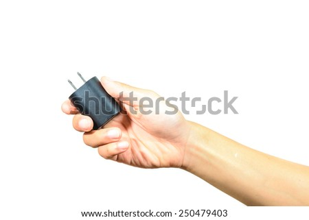 close up of hand holding black electrical plug isolated on white