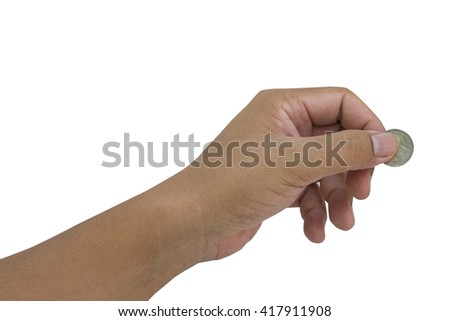 close up of hand holding coins - stock photo