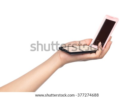 Close up of hand holding cosmetic powder puff isolated on a white background