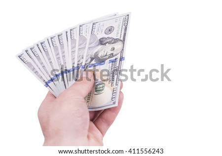 Close up of hand holding dollar bills. Finance, fortune, wealth,  business and profit concept