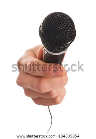 Close-up Of Hand Holding Microphone On White Background - stock photo