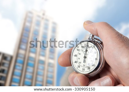 Close Up Of Hand Holding Stopwatch  - stock photo