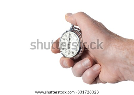 Close Up Of Hand Holding Stopwatch On White Background